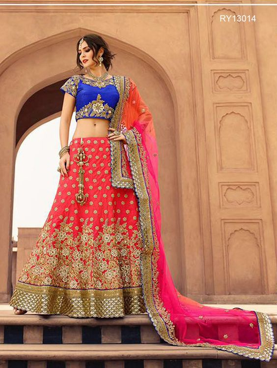 Buy Designer Bridal Lehengas, Wedding Lehengas Online : Vibrant coral pink and blue raw silk unstitched lehenga choli decorated with intricate zari work. Paired with a matching dupatta. It can be customized upto size 42. *Call / Whatsapp / Viber : +91-9052526627 *Email : customercare@natashacouture.com *Worldwide Shipping | Free shipping in India | Cash on delivery *