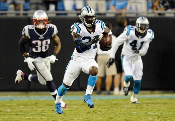 Carolina Panthers' Charles Tillman (31) heads upfield after intercepting a New England Patriots' Tom Brady pass during the first half in their preseason game at Bank of America Stadium on Friday, August 28, 2015. New England led, 7-6, at halftime.