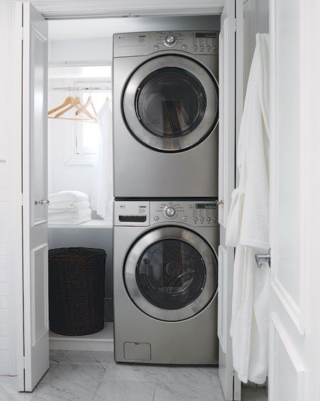"Stacked appliances. Laundry basket slot maybe up higher? Folding and ironing space down low. Cabinet for detergents, etc. All in a ""closet""."
