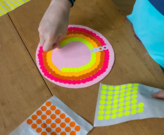 Apply stickers in concentric circles for mandala art