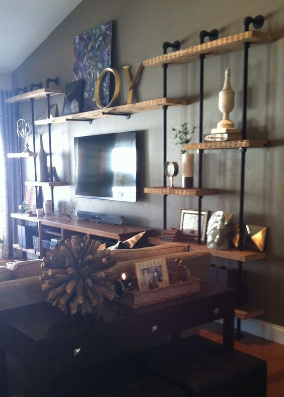 DYI Industrial style shelving for TV wall... Can place piping perpendicular to wall with FLANGE