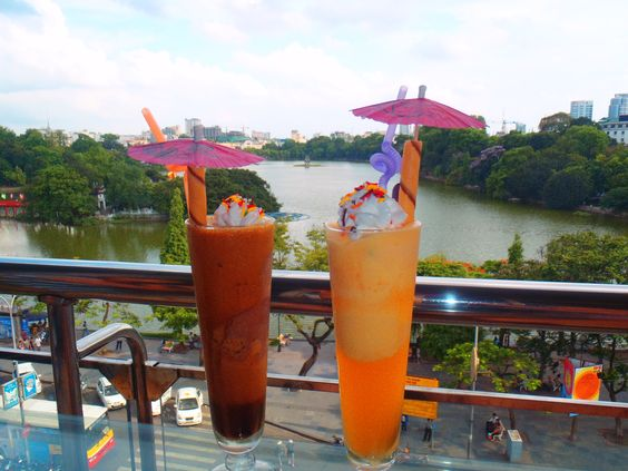 Happy drinks in the middle of crowded Hanoi