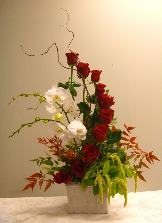 Unique valentine 39 s rose arrangement designed by kari Christmas orchid arrangements