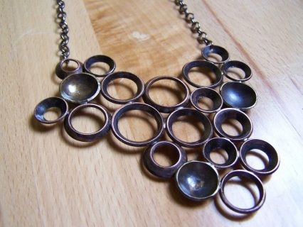 Gun metal chain with brass cups and copper washers. Liver of sulfur patina.