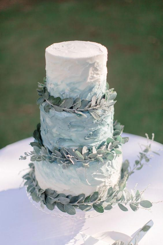 A Textural Blue Watercolor Wedding Cake Decorated With Eucalyptus