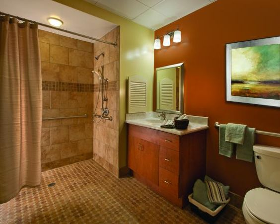 Wood casework, warm colors, and decorative tiles help ...