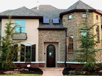 Mixed media exterior brick stone stucco and concrete for Mixing brick and stone
