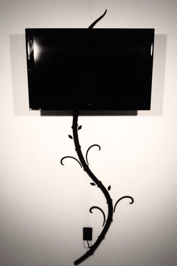 Hide tv and digital picture frame cords without cutting holes in your wall with my creation the Tv-Tree. on Etsy, $30.00