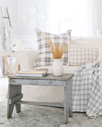 Touches of fall with neutral plaids.