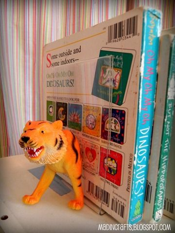 Make kid's bookends from dollar store animals and picture frames