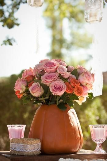 pumpkin and pink floral arrangments: