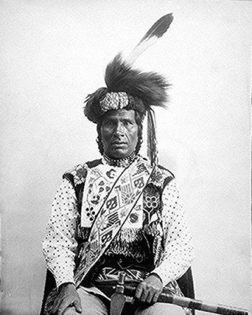 One-Called-From-A-Distance (Midwewinind), a Chippewa from White Earth Reservation, Minnesota; half-length, seated, showing beadwork sash and vest, 1894. American Indian Select List number 14.From: http://www.archives.gov/research_room/research_topics/native_americans/select_list_014.html.