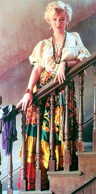 Marilyn, looking like a goddess on the stairs, working vintage boho in a pretty multi-colored skirt.