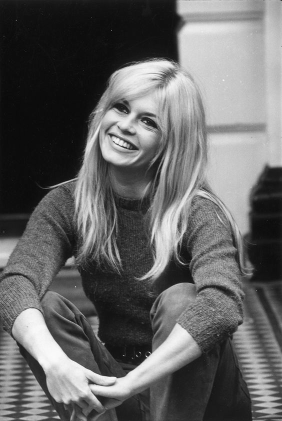 Brigitte Bardot is a blonde with bangs pushed to the side, looking lovely and casual in 1966. Credit: Hulton Archive/Getty Images