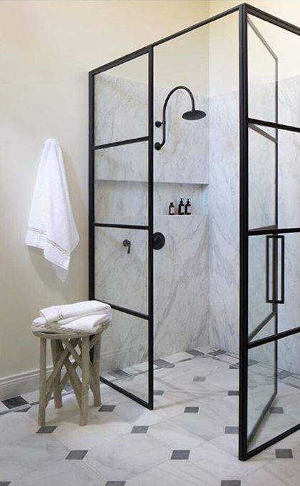 Black framed shower walls and door in a bathroom designed by Amy Meier. Jo Malone London Body & Hand Wash (In case you need it!)