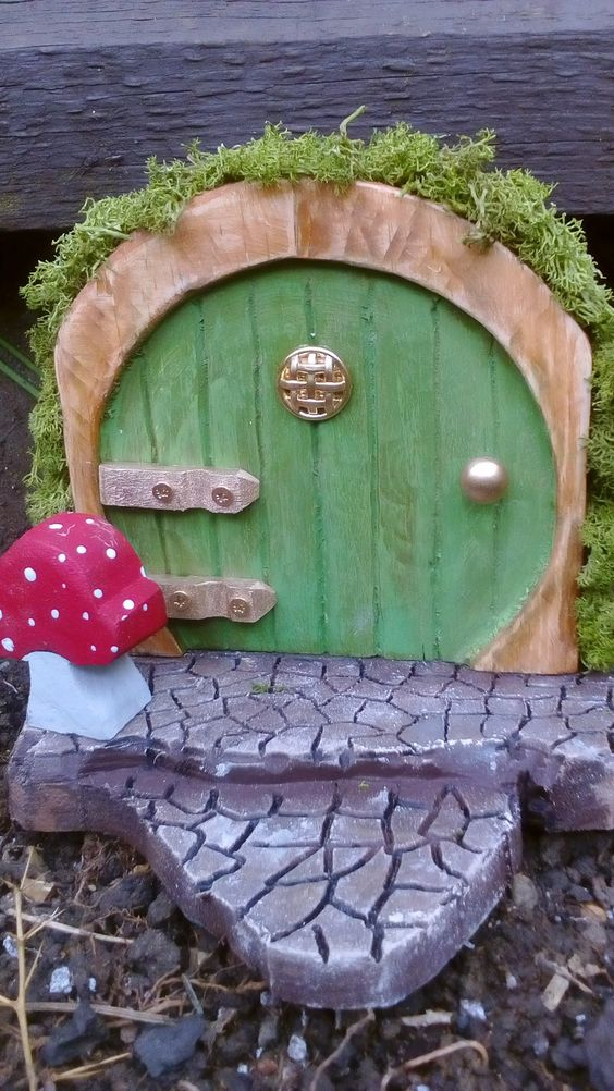 #Door, #Fairy, #Garden, #RecyclingWoodPallets These fairy doors were made from offcuts of pallets I was using for another project; I used my router to recess the doors and create the effect of door slats and crazy paving.