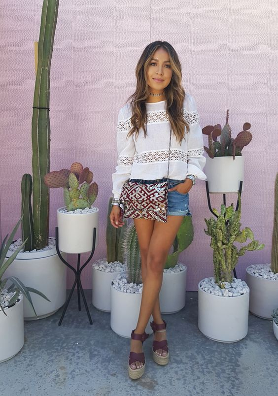 A bohemian style is only complete once you've worked in some statement prints! Julie Sarinana spruces up this cute and casual look with an ultra bohemian embroidered bag, paired with platforms and accessories for a stylish aesthetic.Shorts: Tularosa, Top: Shop Sincerely Jules.
