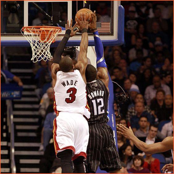 """G Dwayne Wade (6' 4"""") blocks C Dwight Howard (6' 11"""")"""