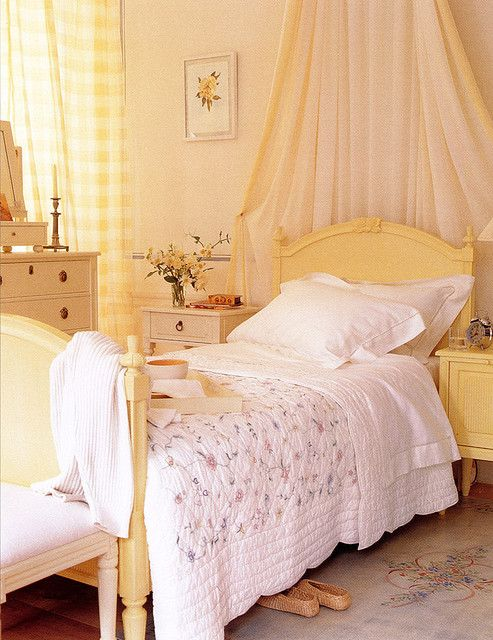 A light and airy yellow bedroom