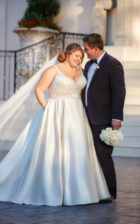 Turn heads on your wedding day in this beautiful plus size wedding gown