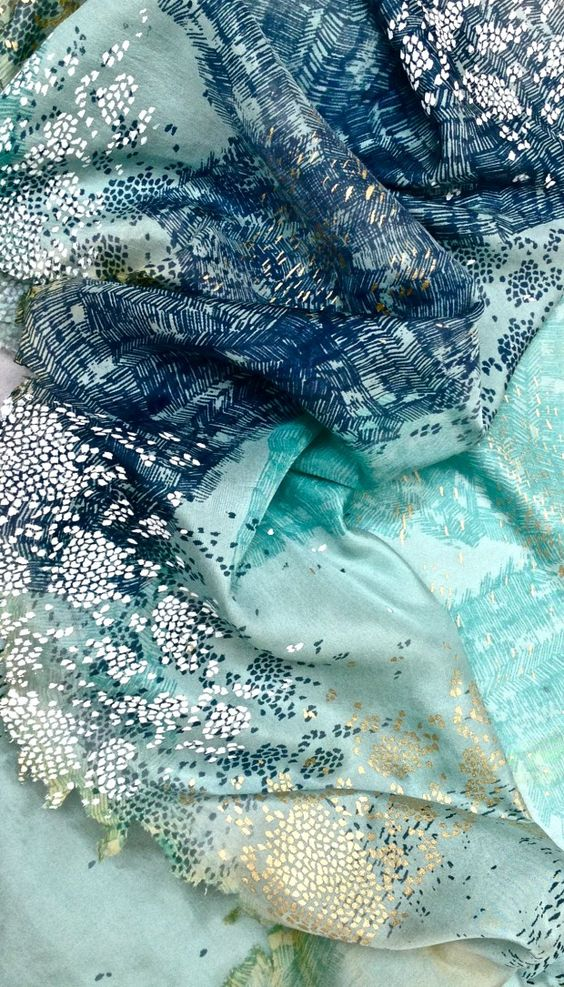 Just as much as I love jewel tones + gold, I LOVE teal/turquoise/blue & silver. And as far as abstract prints go, I like these smaller, subtler ones.