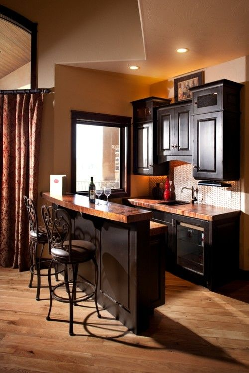 Traditional Living Room With Dark Wet Bar And Backsplash