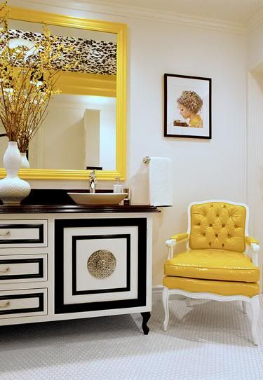 love the yellow tufted chair and black and white dresser