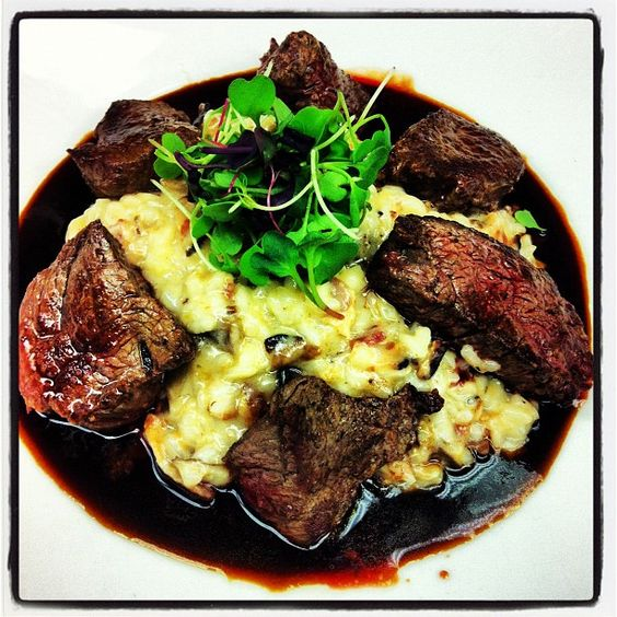 Seared Beef Medallions with Nueske's Bacon and Wild Mushroom Risotto with Raspberry Veal Reduction. YUM!