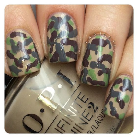 Camo nails.  I used OPI Infinite Shine Maintaining My Sand-ity as my base. Then, using a dotting tool I added random shapes using a mixture of To Finish Lime! and Steel Waters Run Deep for the green color, Set in Stone, and Steel Waters Run Deep.  I received the OPI products as part of #PreenMeVIP program.