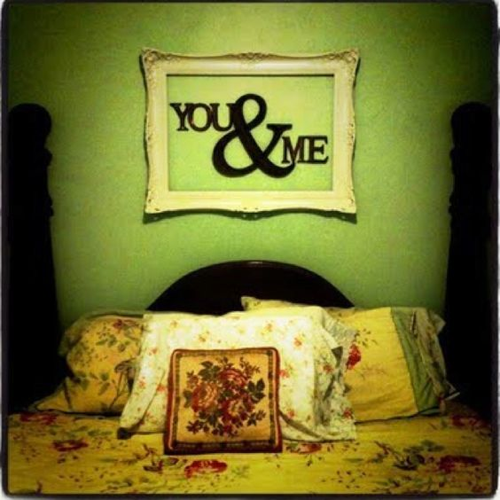 I love the frame above the bed!