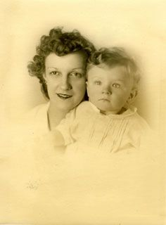 """Soldier John S. Sonnen had more than just his """"girl back home"""" to miss during his two years away from home. He and his wife, Georgiana, had a son, Stuart, who was 18 months old at the time of John's enlistment.    This photograph of Georgiana and Stuart, taken in 1943, was carried by John throughout his Army career as a gentle reminder of his loved ones """"back home."""""""