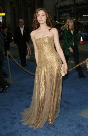 wearing Ralph Lauren Fall 2006 Gold Strapless Gown. Emmy Rossum Poseidon Film Premiere May 10 2006