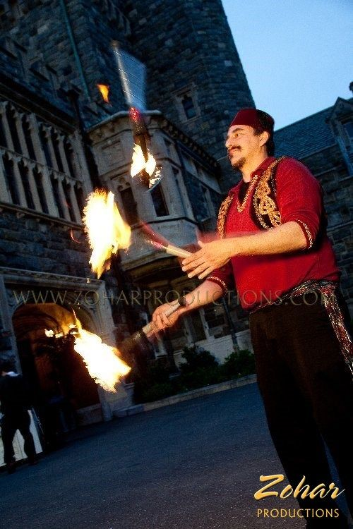 Fire Juggler and other Arabian style entertainment booked through www.ZoharProductions.com  Contact: info@zoharproductions.com