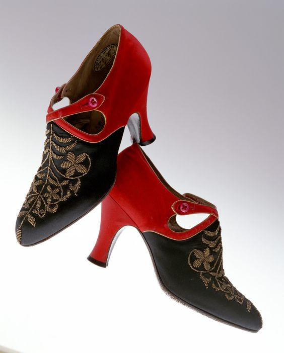 Pumps    1920s    Designer:       André Perugia  Brand:       Perugia  Label:       Perugia BTÉS.G.D.G.21 AVEN.DAME.NICE 11.FAUBG ST HONORÉ PARIS  Material:       Red and black silk satin; floral embroidery of metal beads; buttoned straps.  Dimension:       23.0cm (length) / 7.0cm (width) / 8.0cm (height of heel)
