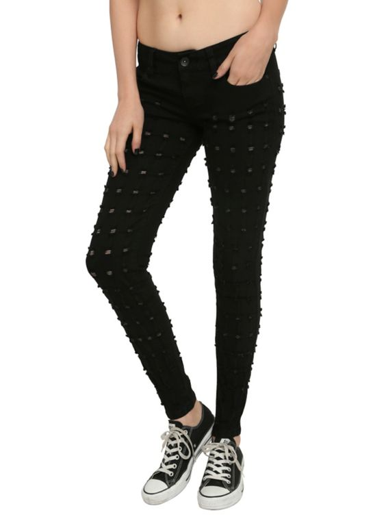 Black skinny jeans from LOVEsick with bullet hole detailing on the legs.
