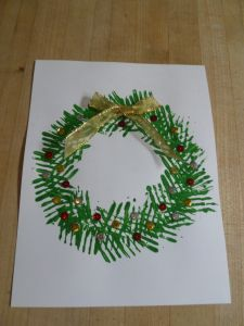 Make a Christmas wreath by painting with a fork. Holiday History & Craft December 2015