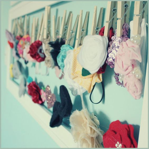 baby headband holder in frame with clothes pins
