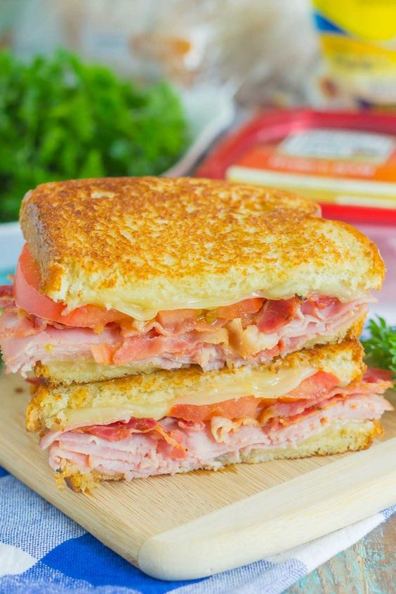 Thinly sliced honey ham, swiss cheese, fresh tomatoes, and crispy bacon are…
