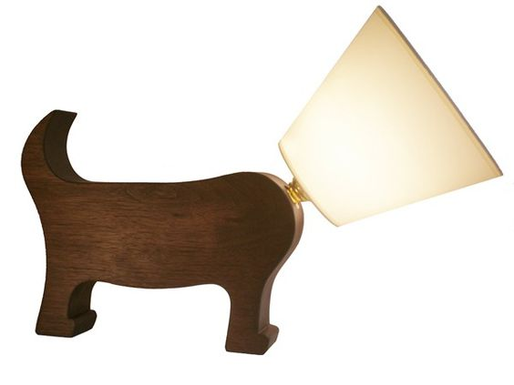 A hand-made solid wood Dog Lamp – a playful wink to the collar of shame.
