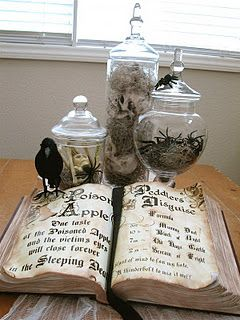 Great way to decorate for Halloween.  Michael's carries those glass apothecary jars and the Spanish moss.