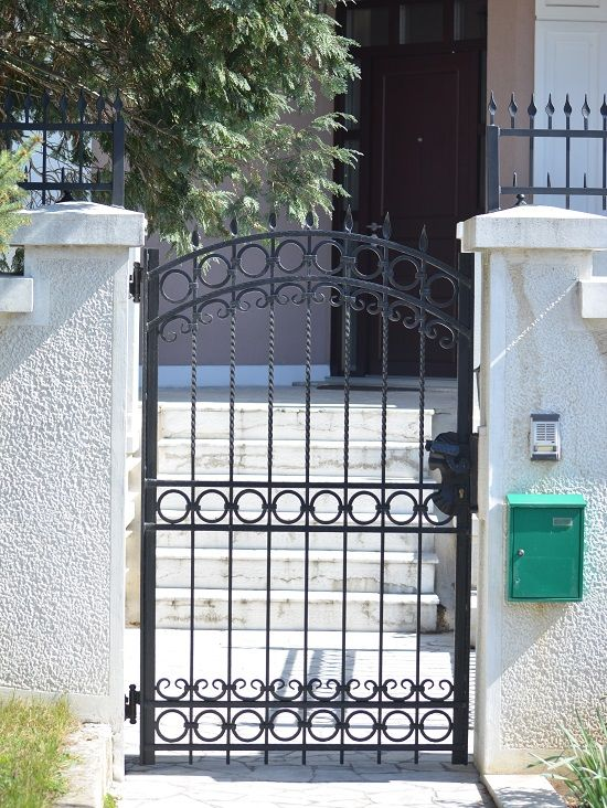 Home ideas for simple iron gates design wrought iron for Home gate design