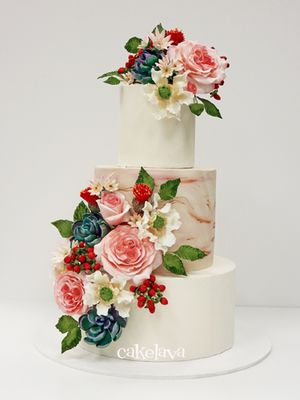 A fondant wedding cake with a marbled middle tier and pink floral and succulent decorations. | cakelava in Las Vegas, NV