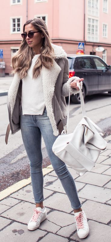 Winter Outfit Ideas: Kenza Zouiten is wearing a jacket and skinny jeans from Acne with Adidas sneakers