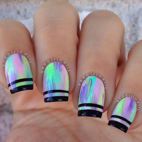 Coat your nails in multi color and add black metallic strips for the French tip and look absolutely cool.