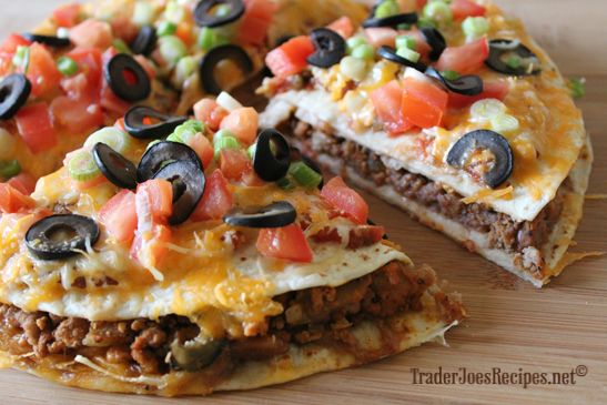 Mexican Pizza  Ingredients: 1/2 pound Ground Beef or Ground Turkey 1 medium onion, diced 1 clove garlic, minced 1 tablespoon chili powder 1 teaspoon ground cumin 1/2 teaspoon paprika 1/2 teaspoon black pepper 1/2 teaspoon salt 1 15-oz can Traditional Style Fat Free Refried Beans 4 9-inch flour tortillas 1/2 cup Chunky Salsa, or your favorite salsa 2 cups Lite 3 Cheese Blend 2 green onions, chopped 2 roma tomatoes, diced 1/4 cupBlack Pitted Olives, sliced