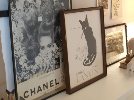 Vintage fashion ads framed and placed on piano/Chanel ads/Hello Lovely Studio