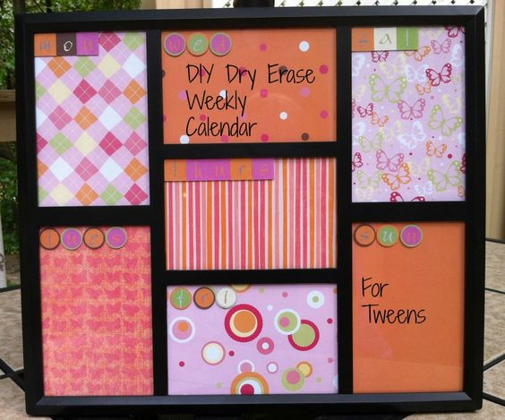 DIY Dry Erase Weekly Calendar made using an inexpensive photo frame and scrapbook paper.