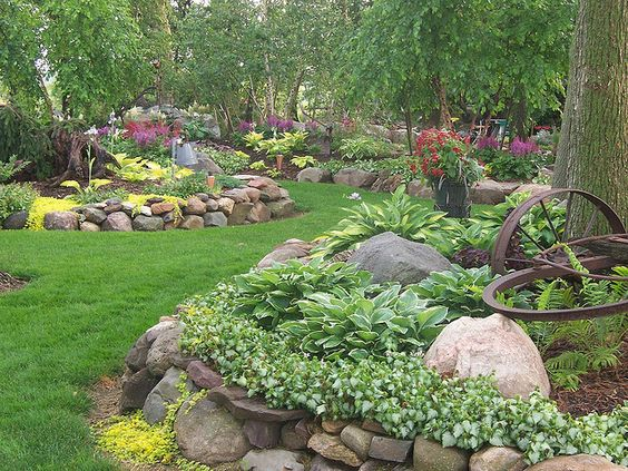 Love the stacked rocks in this shade garden.
