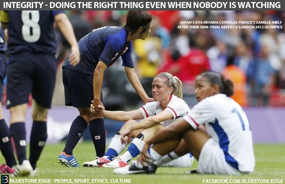 Japan's Aya Miyama console's France's Camille Abily after their semi-final defeat @London Olympics 2012. Representing integrity and sportsmanship in sport.