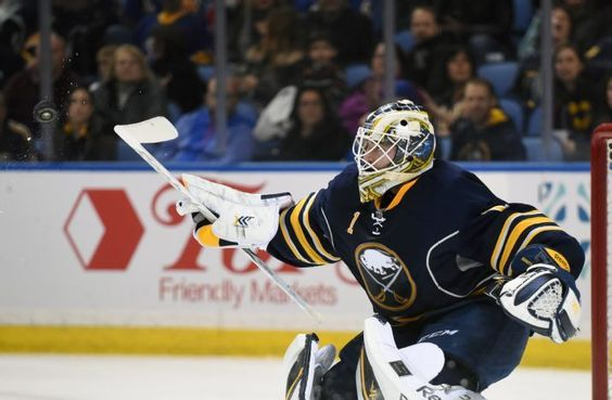 Buffalo Sabres goaltender Jhonas Enroth, of Sweden, knocks away the puck during the second period of an NHL hockey game against the Dallas Stars, Saturday, Feb. 7, 2015, in Buffalo, N.Y. Buffalo won 3-2. (AP Photo/Gary Wiepert)